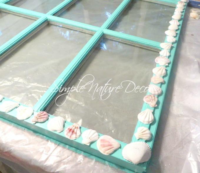 Glueing seashell on window:how to repurpose an old window