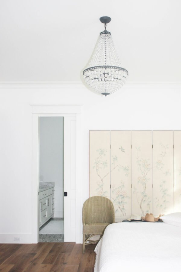 create a statement with lighting fixtures in the bedroom