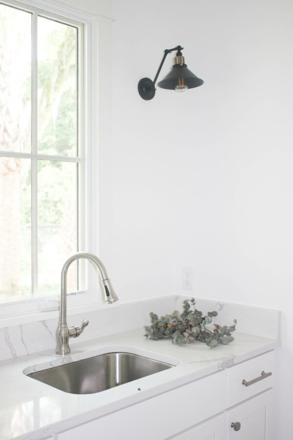 create a statement with lighting fixtures in the laundry room