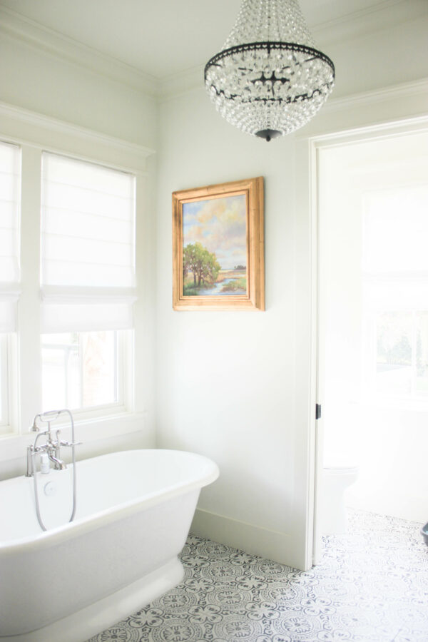 create a statement with lighting fixtures in the bathroom