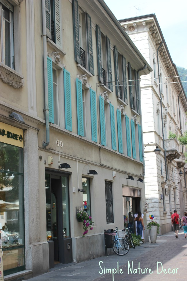 turquoise shutters on building in italy