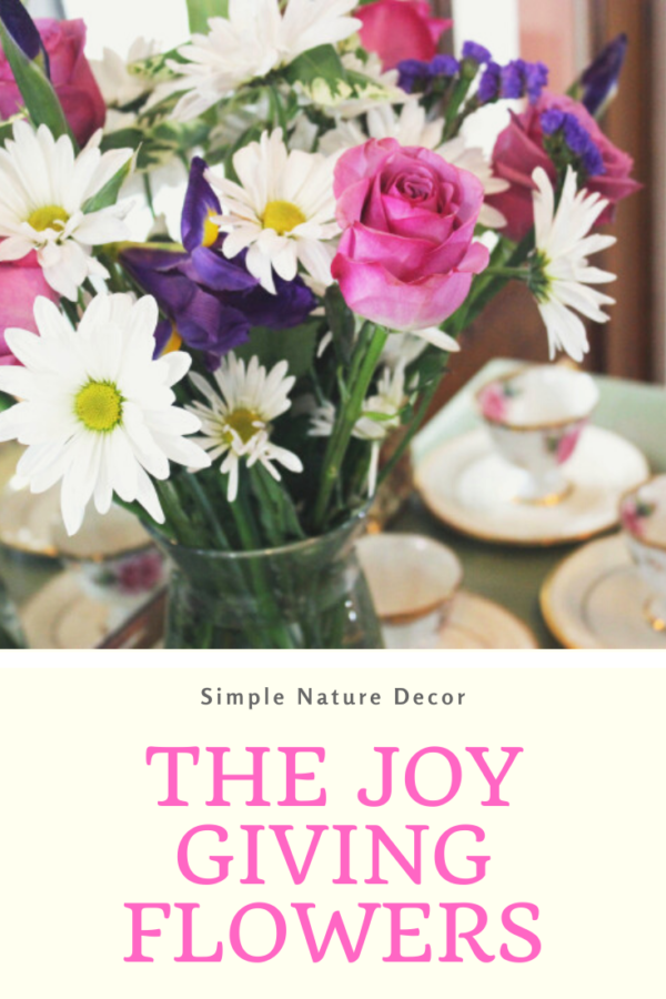 This image has an empty alt attribute; its file name is The-Joy-Giving-Flowers-e1577368469134.png