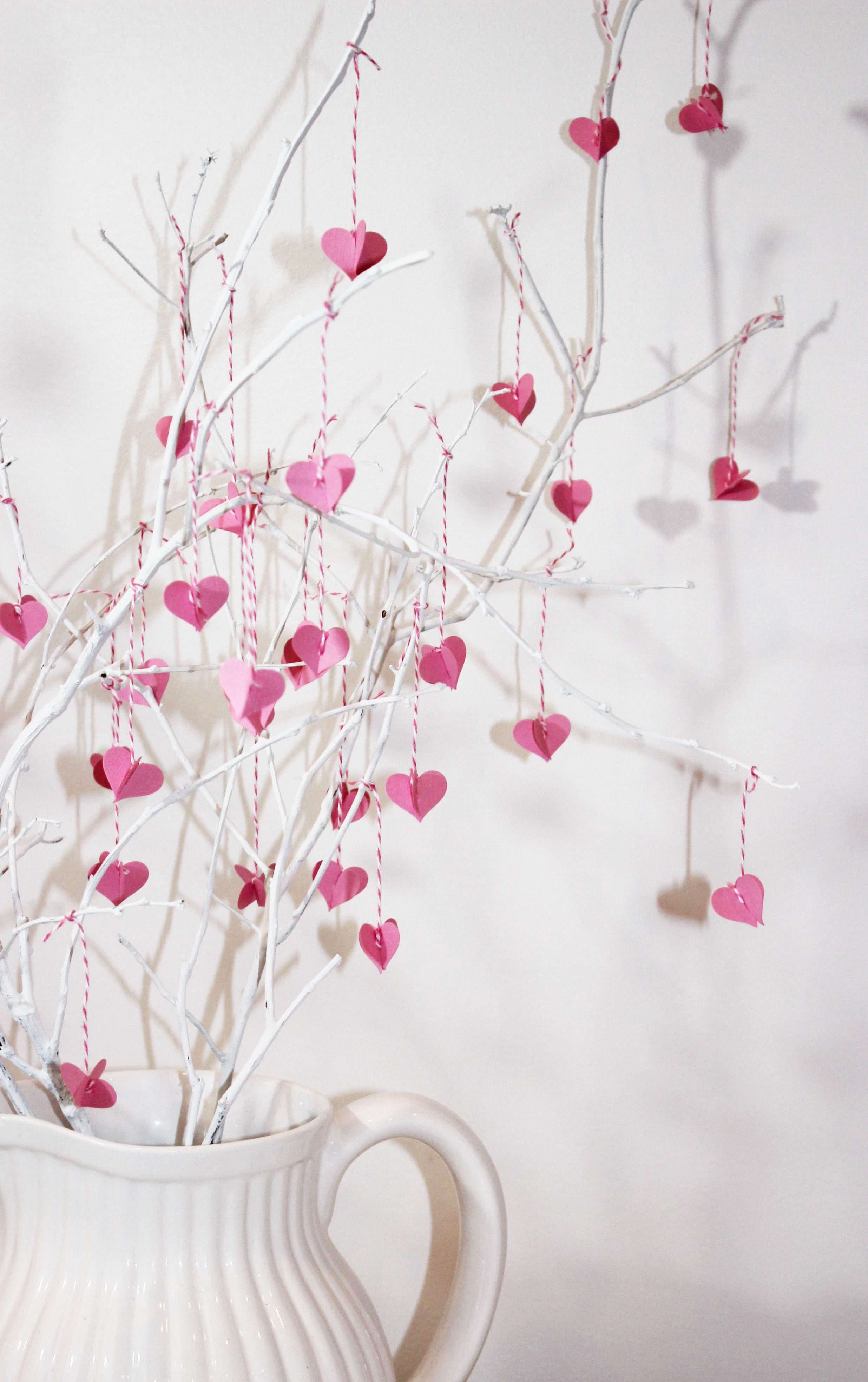 valentine paper hearts hanging from branches