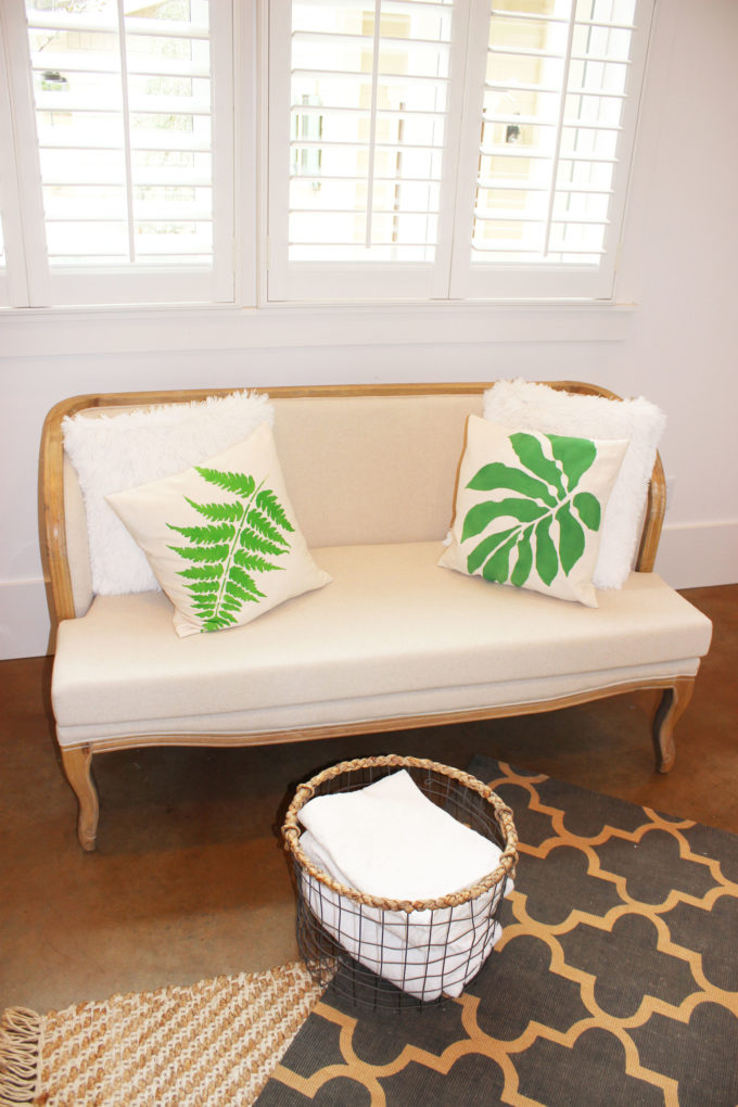 botanical pillows on chair: How To Stencil Botanical Leaf On A Pillow In 6 Easy Steps