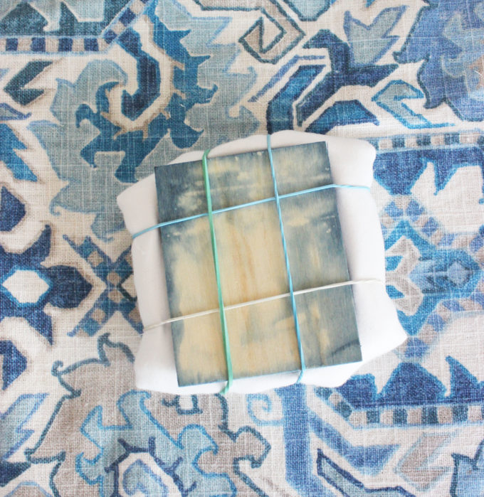 creating the design by tieing:  4 Easy Steps On How To Make A Hand-Dyed Shibori Pillow Cover.
