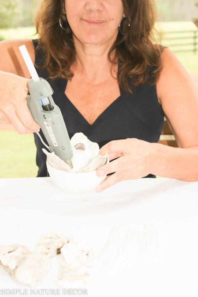 Gluing the oyster shell candle holder