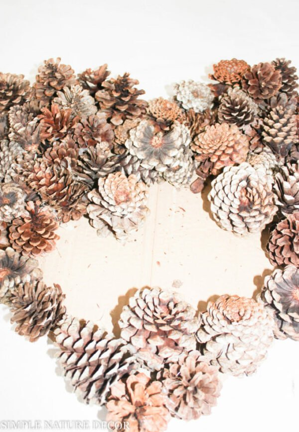 fill center of valentine wreath with pinecones
