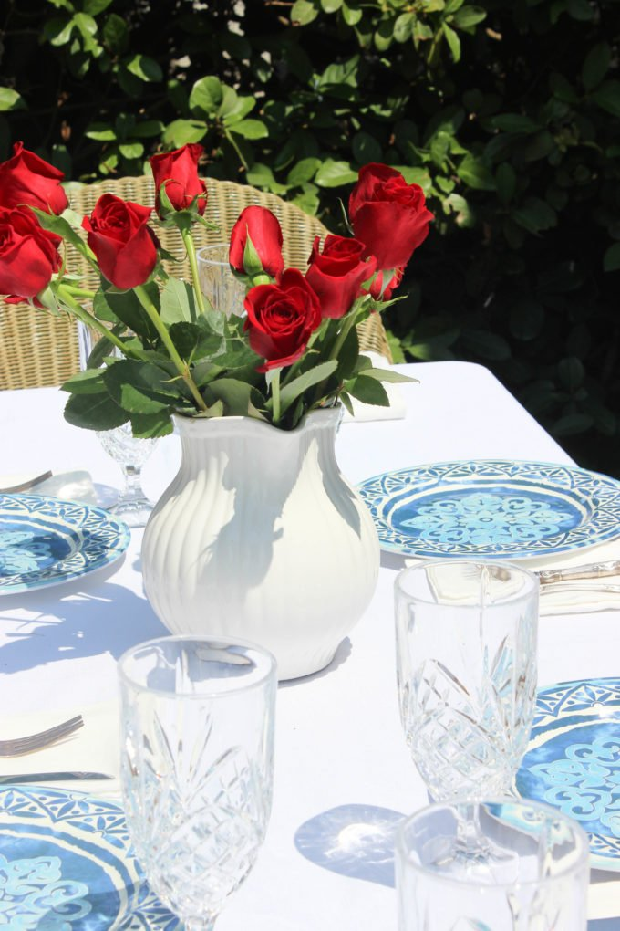 red roses for Get Ready For Spring With A Timeless Blue and White Tablescape