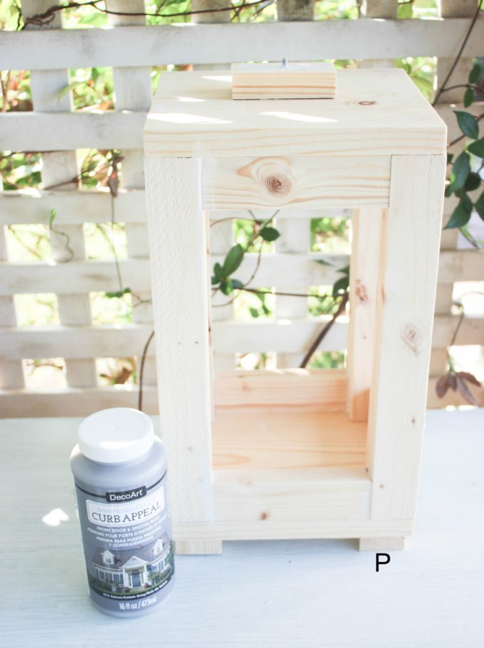 putting the lantern together from scraps of wood