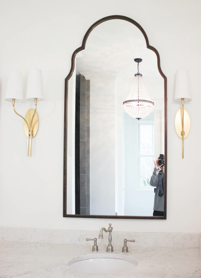 create a statement with lighting fixutres in bathroom