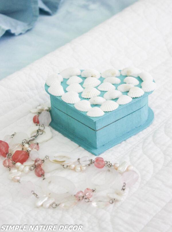 seashells on heart shaped trinket box