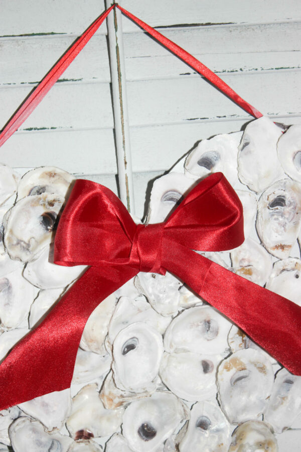 oyster shell wreath with red bow