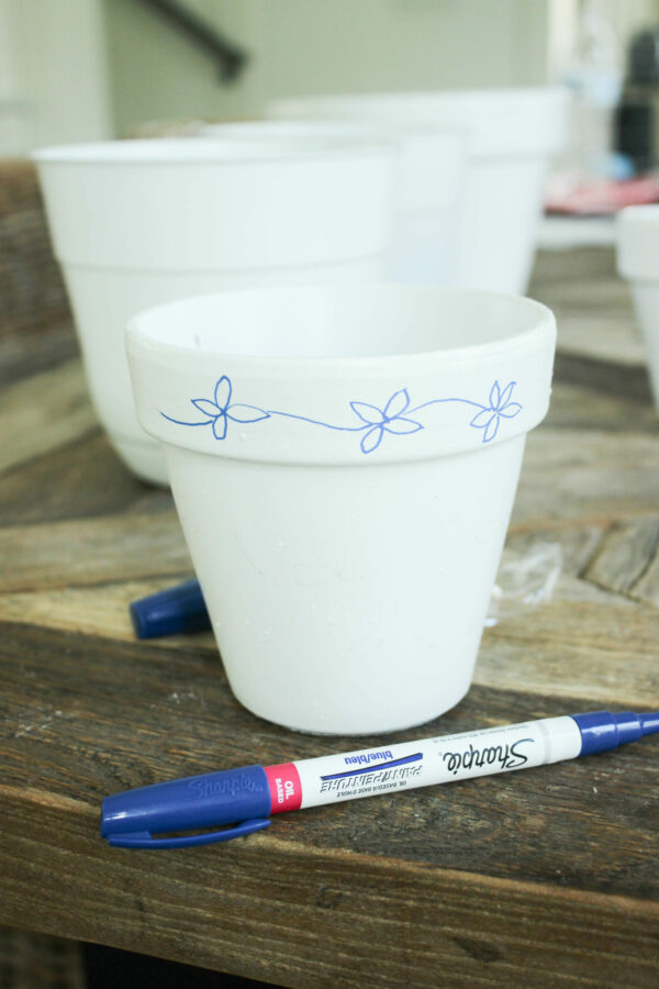 desiging the flower on pots How To Hand Paint Garden Pots With Chinoiserie Designs