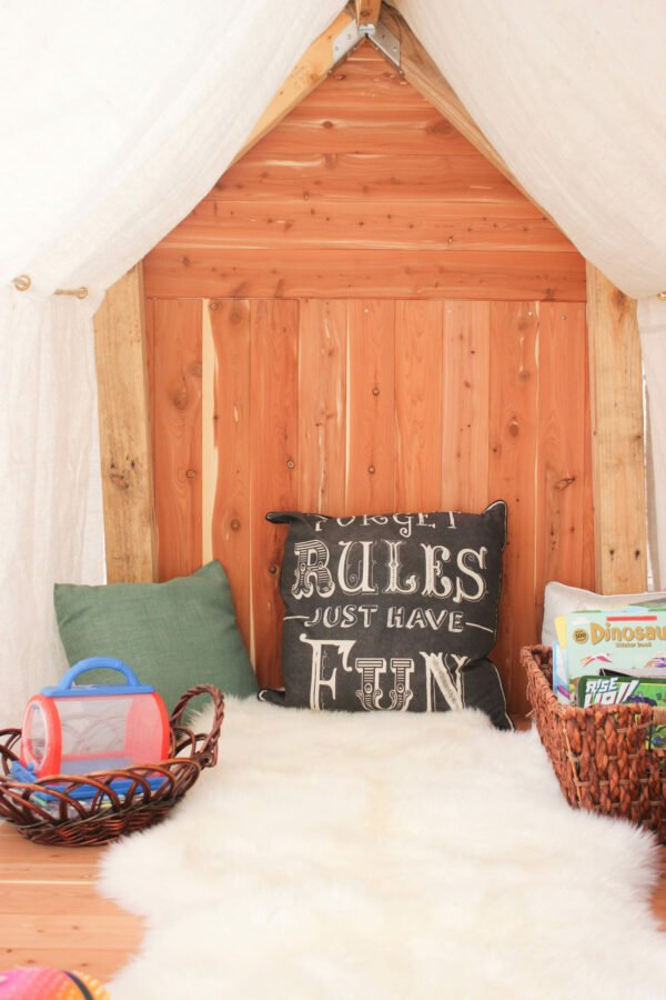 inside of outdoor cedar playhouse How To Make The Cutest Outdoor Cedar Playhouse