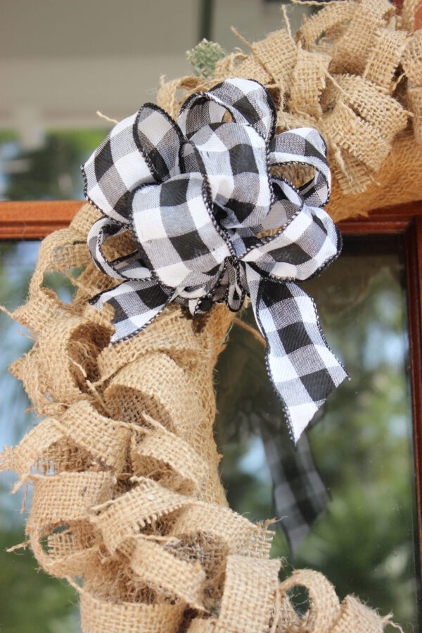 Coffee bean sack with black and white bow: How To Create an Easy Fall Wreath Using Coffee Bean Sacks