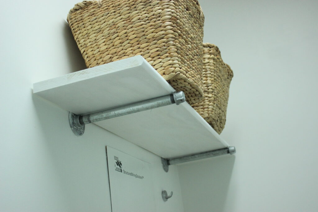 Pipe shelving: Budget-Friendly Laundry Room Makeover Reveal