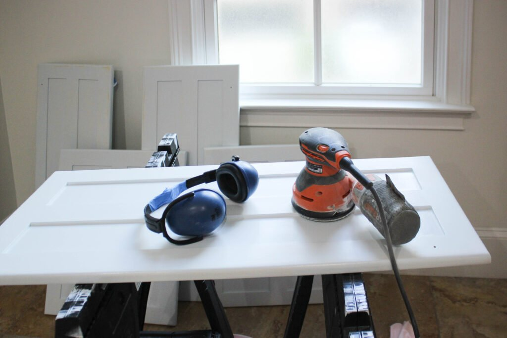 Painting and sanding second coat:5 Tips On Painting Laundry Room Cabinets: Week 2