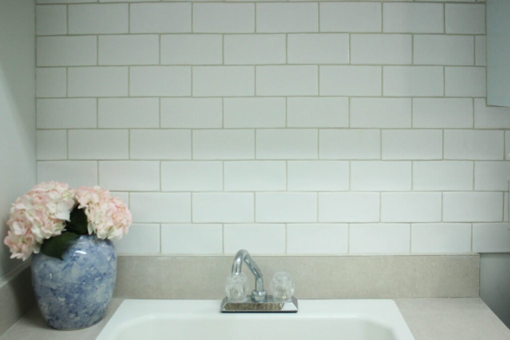 Subway tile backsplash:Budget-Friendly Laundry Room Makeover Reveal