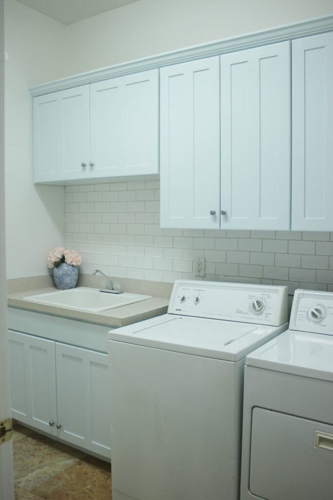 Re-painted cabinets: Budget-Friendly Laundry Room Makeover Reveal
