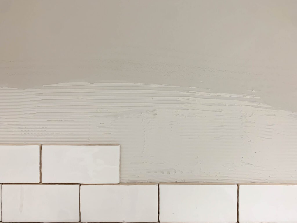 Tile adhesive: How To Install Subway Tile Backsplash In The Laundry Room
