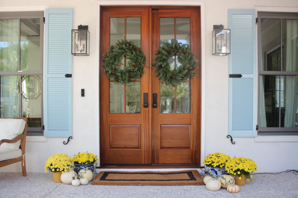 Mums and Pumpkins in the entrance: How To Decorate Double Front Doors For The Holiday