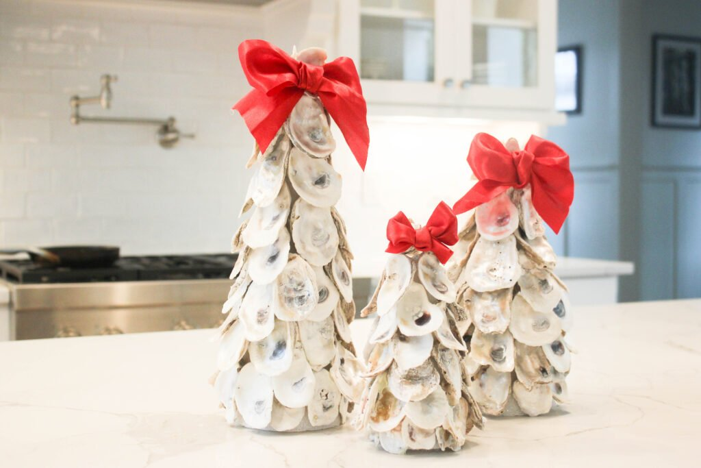 Adding red bows:How To Make Oyster Shell Christmas Tree