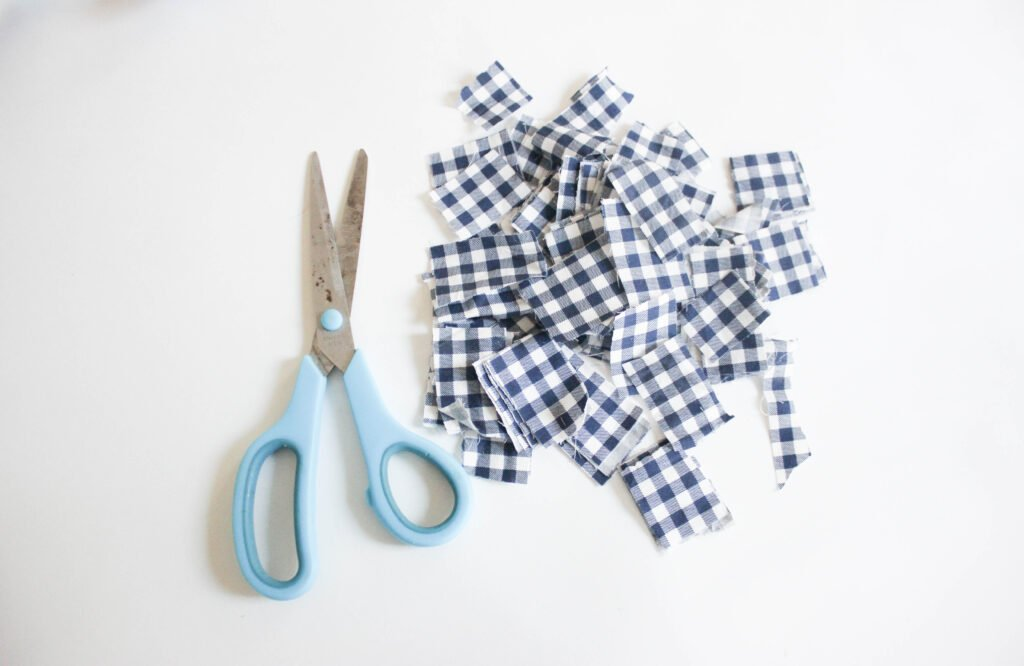 Cutting up fabric squares:How To Decoupage Fabric Ornament Balls