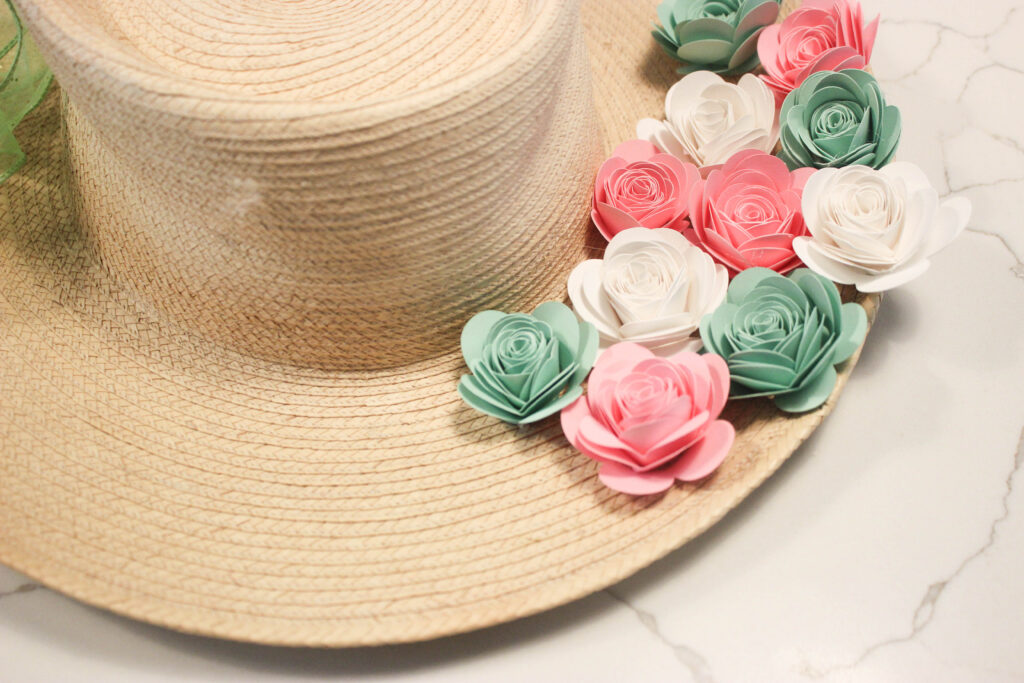 paper flowers on wreathHow To Make a Paper Flower Wreath Using Straw Hat