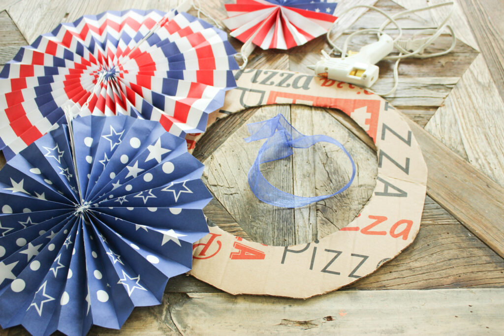 Supplies:How To Make Fourth of July Pinwheel Paper Wreath