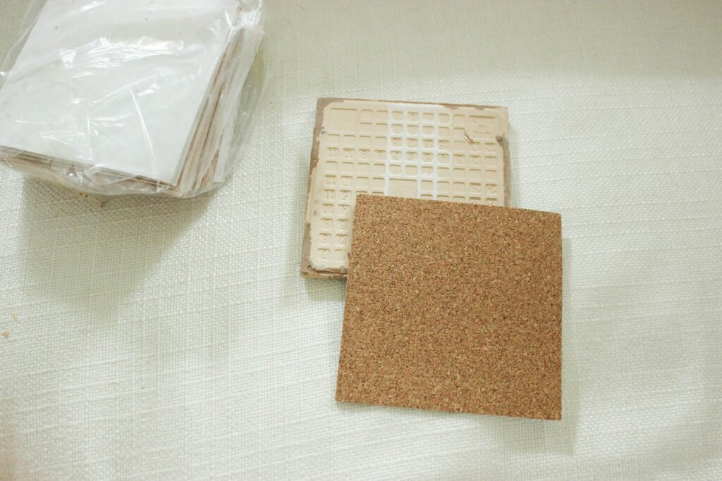Add cork back to your coasters:How To Make Tile Coasters Waterproof