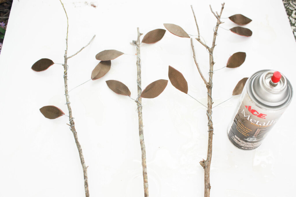 Spray gold paint on faux leaves:Faux Fall Leaves