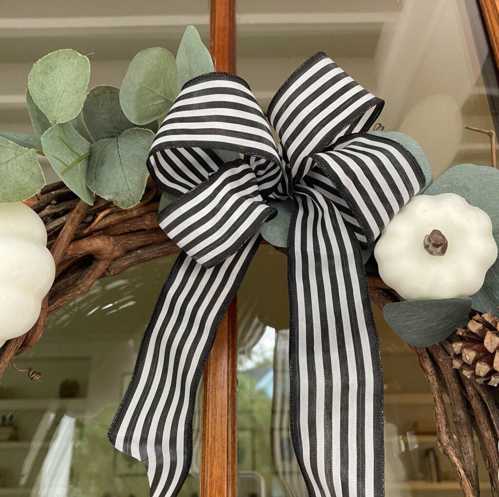 Add a Buffalo print ribbon:white pumpkin wreath