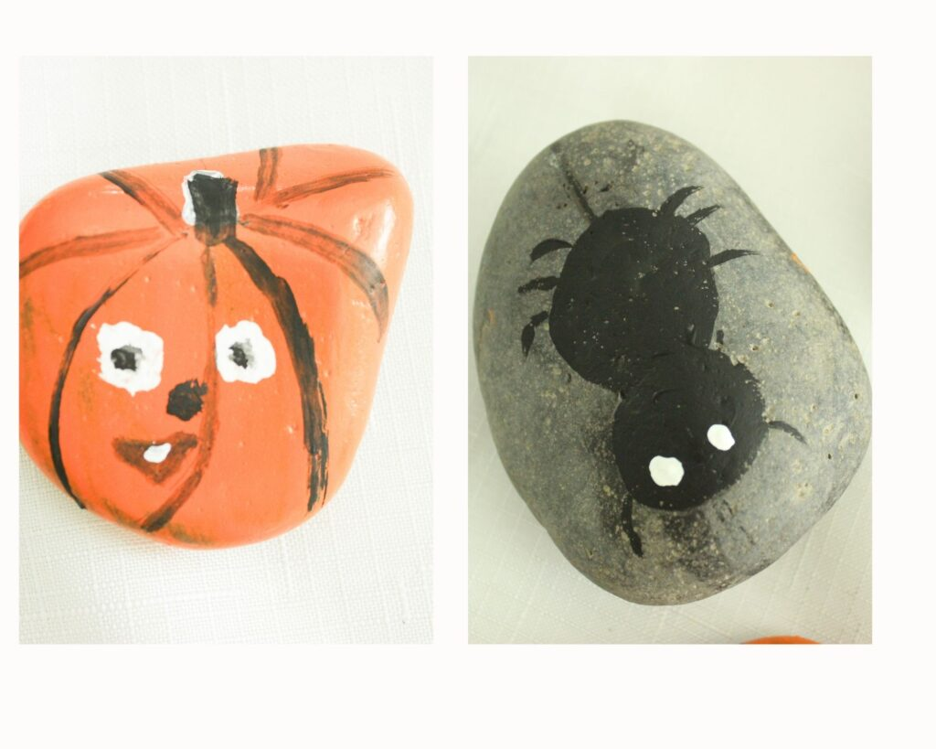 painted spider and pumpkins on rocks:Halloween Rock Painting Ideas