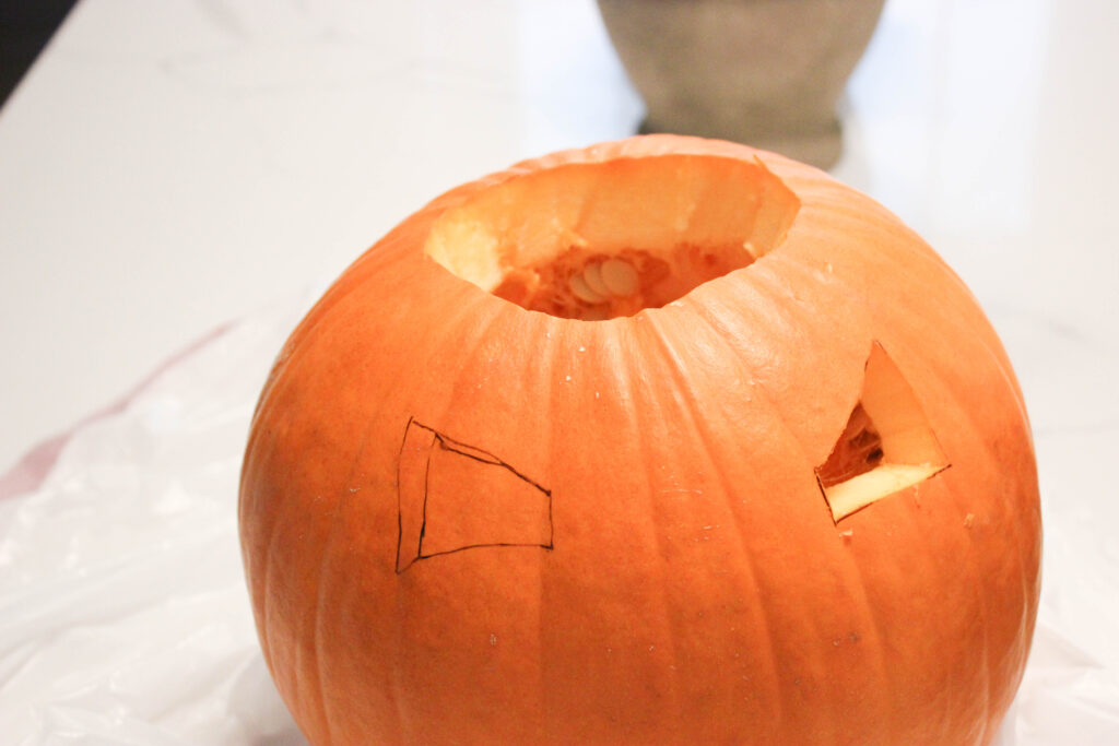 Cut out shark eyes:How To Carve A Pumpkin Shark